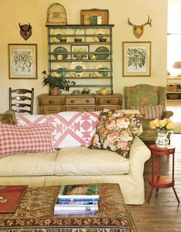 Warm Family Room    Soft neutral walls, vintage fabrics, and displayed collectibles make this room feel homey and lived-in.      Read more: Decorating Ideas for Living Rooms – How to Decorate a Living Room - Country Living