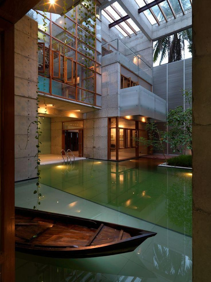 """<p>The studio Shatotto projected this building made of cast-concret, glass and water, in Dhaka, Bangladesh. Like their own motto, """"Architecture for green living"""", the natural elements are essential in"""