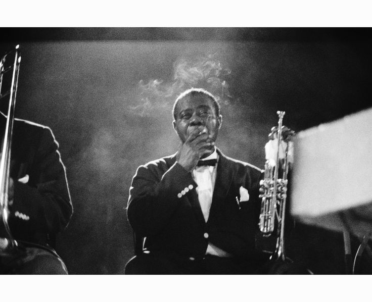 Louis Armstrong on stage    © Ted Williams