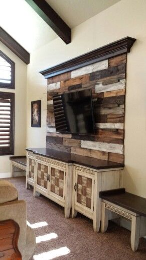 Repurposed old TV hutch cut down & painted along with a new pallet wood wall & top rustic shelf with crown, perfect for new flat screen TV