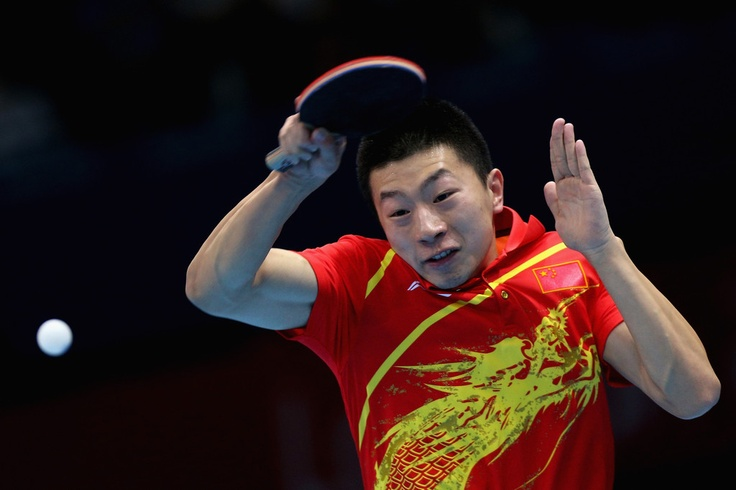 Ma Long of China completes during Men's Team Table Tennis quarterfinal match against team of Singapore on Day 9 of the London 2012 Olympic Games at ExCeL on August 5, 2012 in London, England.
