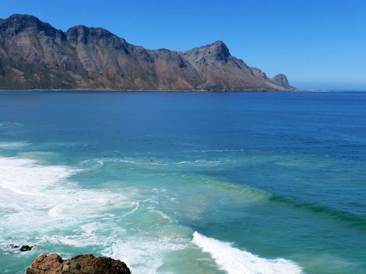 Surfers at Cool Bay and Rooi Els in the distance