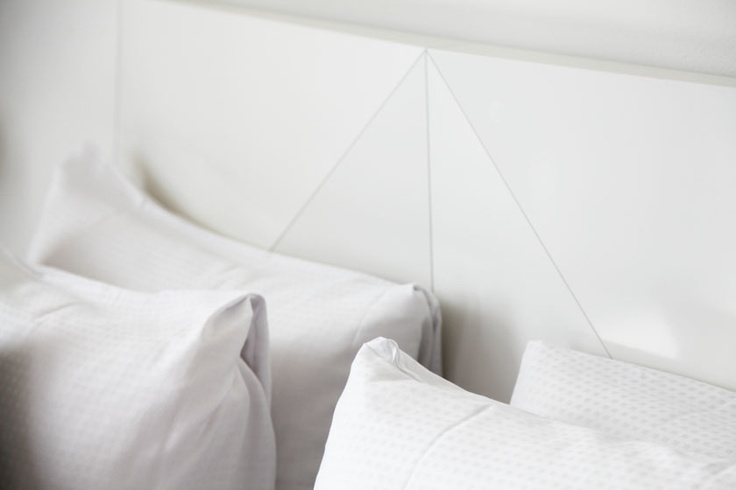 Head board and pillows from hotel room. Bella Sky Design Hotel. White.