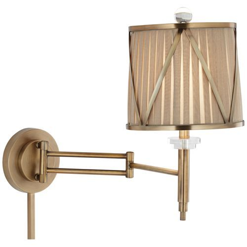 "Emerita Gold Plug-In Swing Arm Wall Lamp  18 1/4"" high x extends 22 3/4"" from wall x back plate is 6"" wide, 6"" high, and 1 1/2"" deep. Recommended bulbs are 43 watt energy efficient soft white halogen; equivalent to a 60 watt incandescent (bulbs not included). Contemporary plug-in swing arm wall lamp. Gold finish, textured shade. Dimmer switch on socket. Shade is 9"" across the top, 10"" across the bottom, and 8 1/2"" high. Includes 12"" and 18"" cord covers. Includes 8-foot clear silver cord."