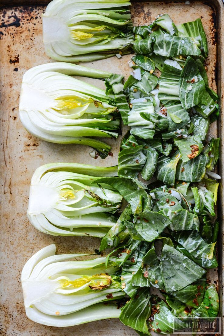 Roasted Bok Choy is a simple healthy way to enjoy your vegetables. Roasted with coconut oil and topped with fresh lemon, tamari and spicy red pepper flakes gives you a dish with an asian flair that goes well with your weeknight dinner.  | ahealthylifeforme #Bok_Choy