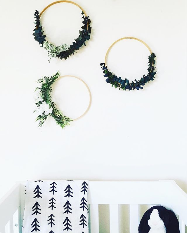 Natural nursery design featuring Modern Burlap's black and white swaddle blankets and gorgeous floral rings.
