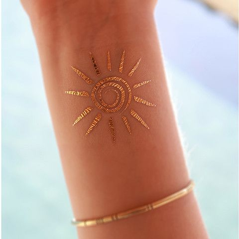 """This is a gold temporary tattoo of a lovely sun design. This tattoo is perfect for wearing to the beach! Sheet Size: 2"""" x 2"""" - Lasts 5-7 days even with swimming and bathing! - Easy to put on and easy"""