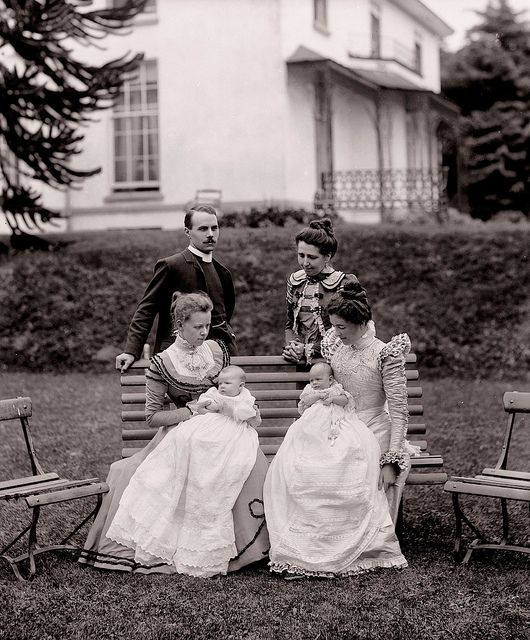 This photo was taken at Sion Lodge, Ferrybank, Waterford. The clergyman pictured had baptised the two babies who are replendent in their christening robes. One of these ladies is Mrs Augustus Smith, but not sure which.