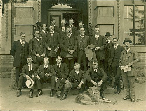 King and King's dog, Sandy with staff at front entrance 1920s. Vintage suits, fashion. Geelong, Australia.