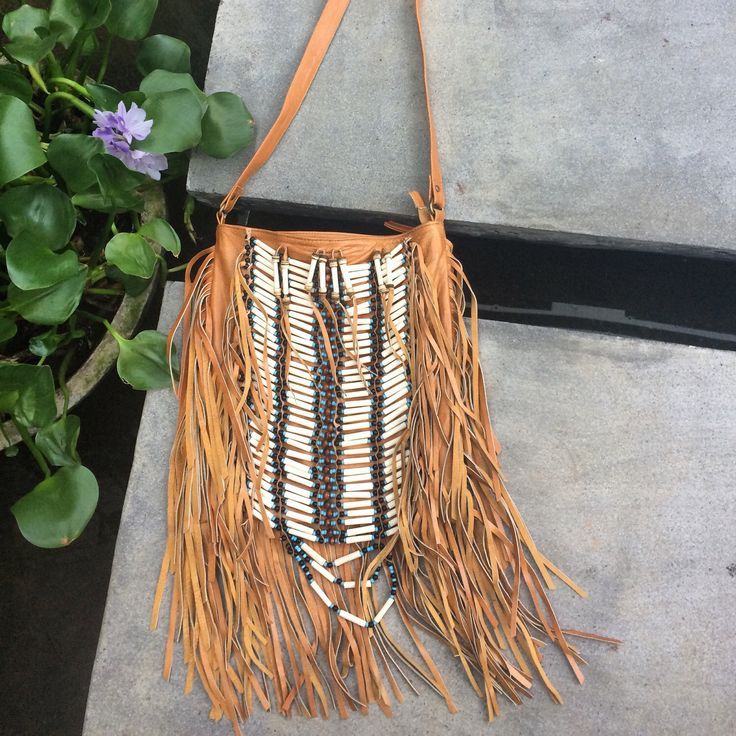 A personal favourite from my Etsy shop https://www.etsy.com/au/listing/228000266/tan-leather-fringe-bag