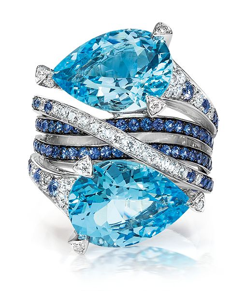 Cellini Jewelers Blue Topaz, Sapphire and Diamond Ring  Pear-shape blue topaz stones are set among crossing bands of sapphires and diamonds, in 18-karat white g