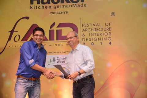 In September HMW attended the 2014 Festival of Architecture and Interior Designing (FOAID). An immensely successful event where we met fellow industry members while we continue to broaden our wings as we're all about striving for the highest quality products and offer superior service to all Handmade World clients.  Here Handmade World Founder Mr. Adarsh Mishra is seen felicitating an industry member