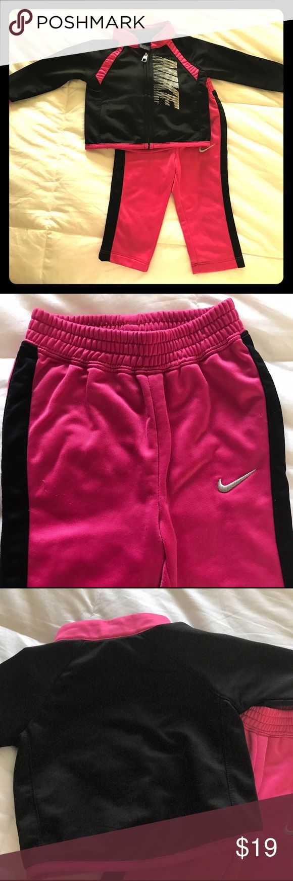 Infant Nike Jogging Suit Pink and black 2 Piece in 100% Polyester includes an elastic waist pant with zip up jacket. A little wear on the knees and price with that in mind. Nike Matching Sets
