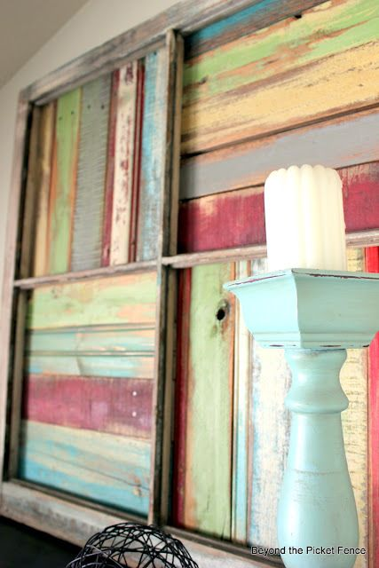 I love this!  Painted pallet pieces in a window frame. From Beyond the Picket Fence.