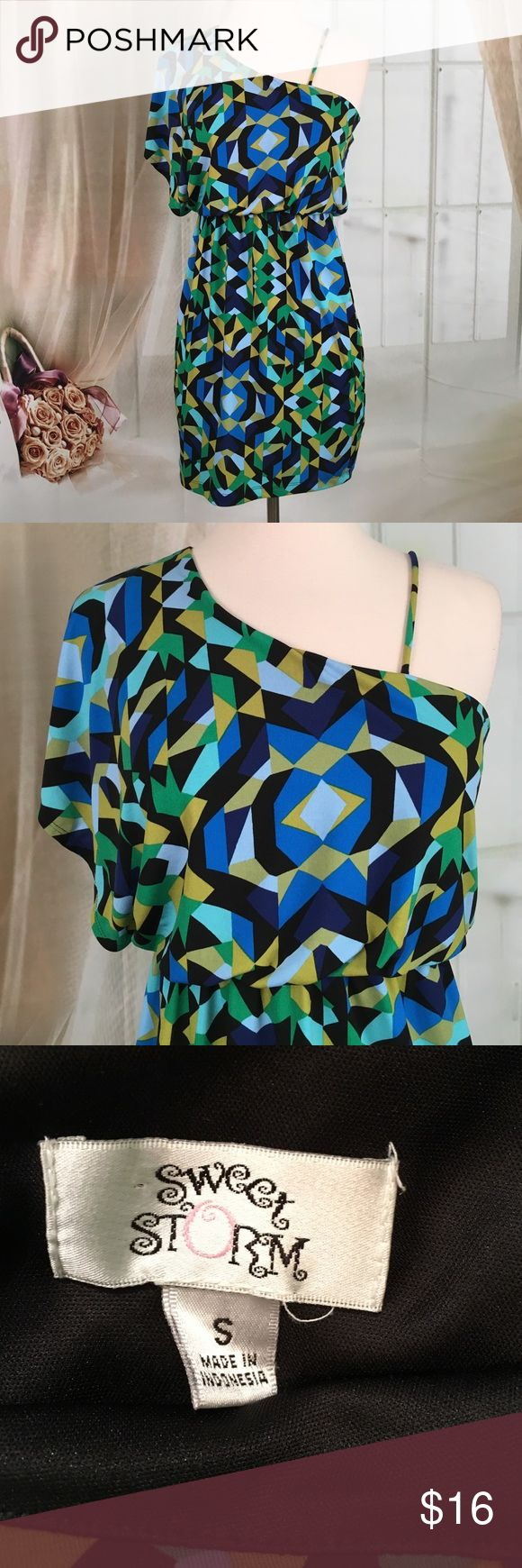 "Sweet Storm Multi Colored Party Dress Very cute little party dress. Colors and blues and greens. Strap on one side short sleeve on the other. Elastic at the waist. 95% polyester. 5% spandex. New condition. Size S. Bust 28 and length 31"".  DR137 Sweet Storm Dresses"