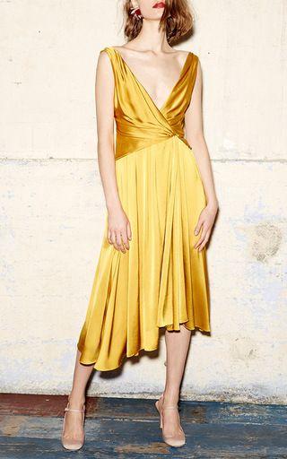 This sleeveless **Paule Ka** dress features an exaggerated v-neckline, a wrap effect at the bodice, and an asymmetrical fluid skirt.