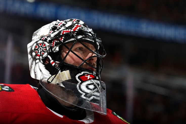CHICAGO, IL - FEBRUARY 06: Goalie Jeff Glass #30 of the Chicago Blackhawks looks across the ice in the first period against the Calgary Flames at the United Center on February 6, 2018 in Chicago, Illinois. (Photo by Chase Agnello-Dean/NHLI via Getty Images)