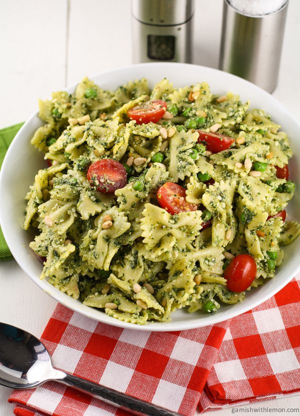 Pesto Pasta Salad with Peas - This would be great warm with chicken and a little bit of lemon drizzled on top :)
