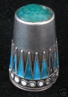 Marius Hammer Silver enamelled thimble (Norway) GBP 56.00 (US$108.11): 11 bids starting at GBP 15.00 (US$29.51). 4 January 2007.
