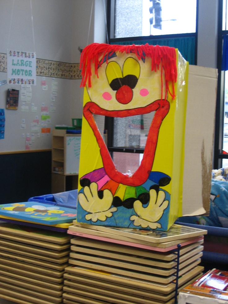 Clown bean bag toss.  Cardboard box, contact paper, sharpie paint pens and red yarn.