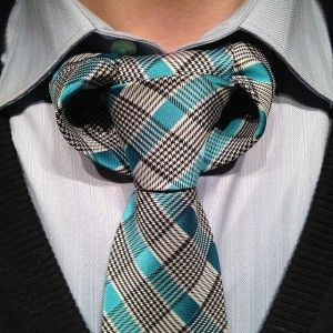 taurus-necktie-knotThis knot was invented by Linwood Darkis (@CrazyLinwood). It is called the taurus because if it's bull like appearance. Although I have also seen people say it looks like a trophy. Both are interpretations are equally awesome. This knot is unlike any other knot in construction, except perhaps some of Linwoods other inventions.