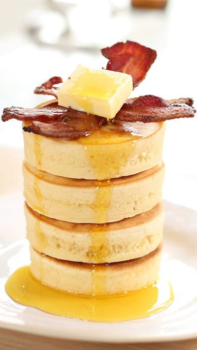 Recipe with video instructions: These might just be the fluffiest pancakes of all time. Ingredients: 1/2 cup plain flour, 1/2 teaspoon baking powder, 1/8 teaspoon baking soda, 1 large egg, 5 tablespoons buttermilk, 1/2 teaspoon vanilla extract, Pinch salt, 2 tablespoons sugar, Butter for frying, 6 strips bacon, Pancake syrup, to serve