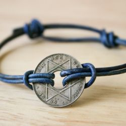 """This is a tut on making a simple, unisex, sliding knot bracelet with an antique African coin."" ~via Craftgawker (goodness I love this site"