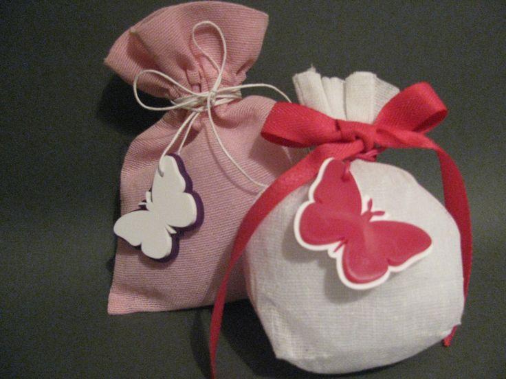 Plexiglass favors mponmpon butterflies .The best choice for girls' christening
