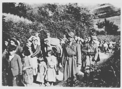 Jewish Yugoslavian women and children are escorted by Ustasa militiamen to the Jasenovac concentration camp.