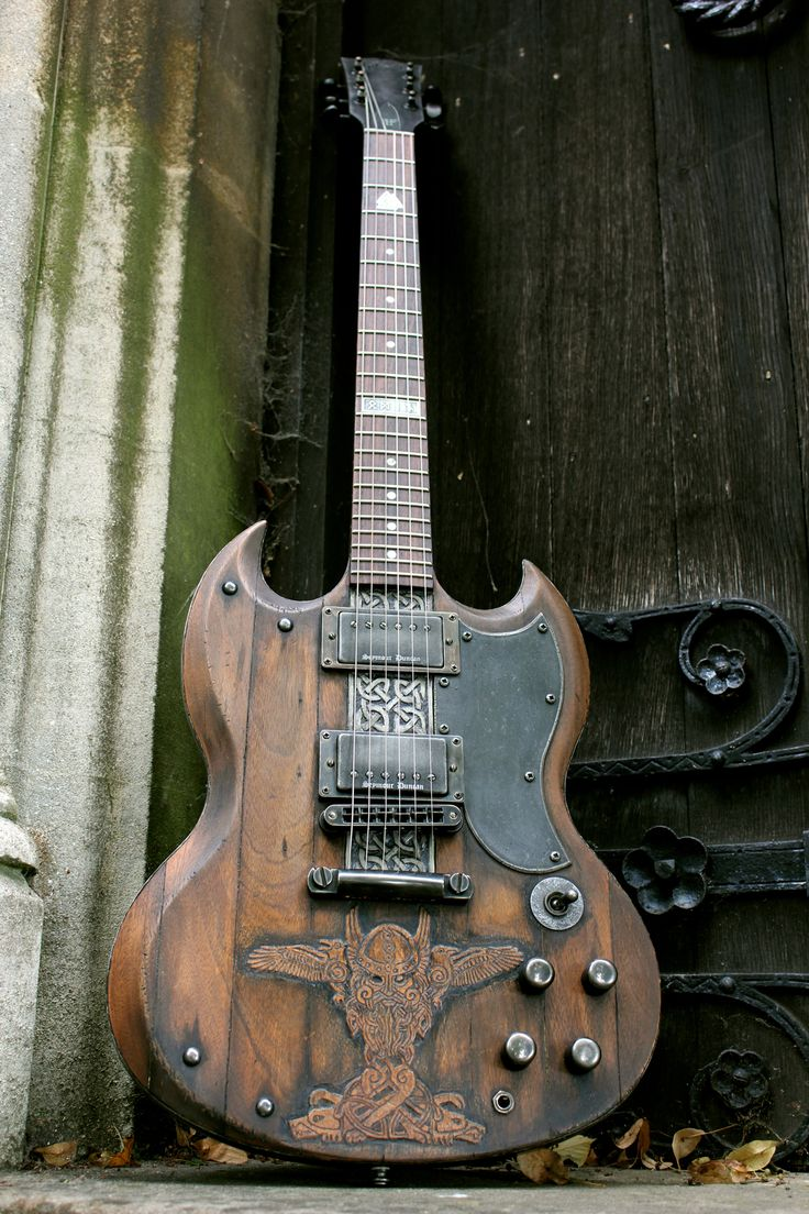 Norse SG from Hutchinson Guitar Concepts - yes, I've already pinned the Les Paul, and I really don't think I have the tools to do either, but I particularly like the carving on the top of this one.