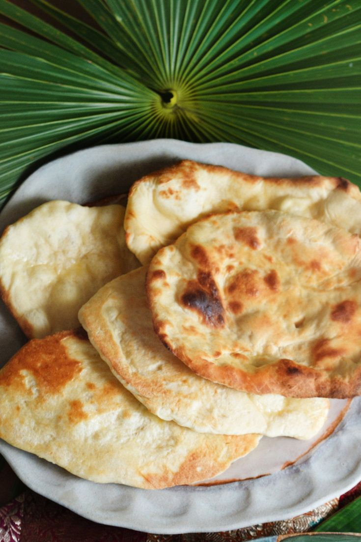 NYT Cooking: In spite of its ancient origins and utter simplicity, the tandoor produces startlingly sophisticated results, including smoky flatbreads that puff like pillows, and roasted meats of uncommon succulence. But you can make naan just as easily in an oven.