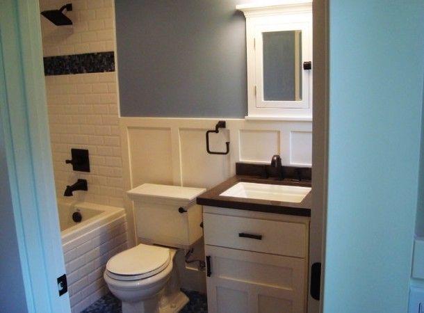 craftsman bathroom with old fashioned bath tub and bathroom cabinet