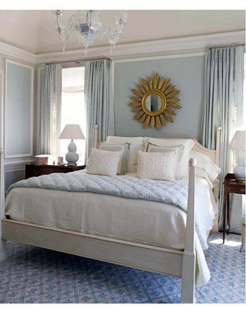 Pale sky blue paint color creates a relaxing retreat in this master bedroom. Color: Benjamin Moore Glass Slipper 1632