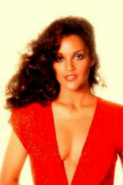 """Jayne Kennedy was the the first woman to join the staff of CBS Sports' """"NFL Today"""" and the first black Miss Ohio. She is seen here wearing a robust curly hairstyle."""