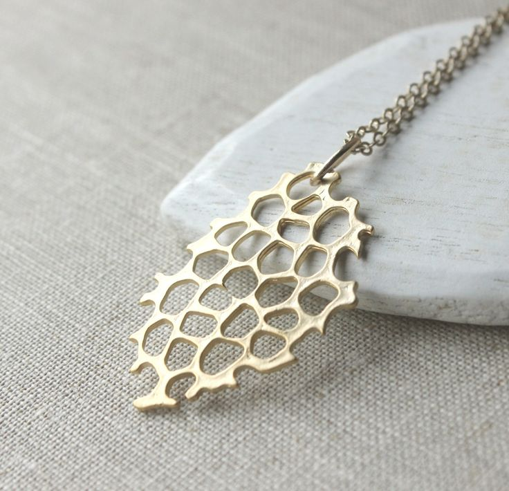 Gold beehive necklace matte gold honeycomb.