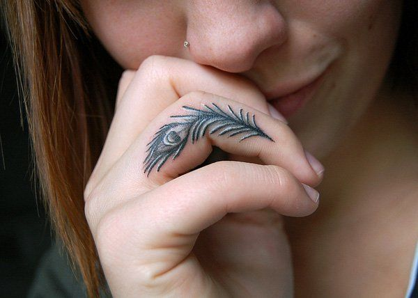 Peacock finger tattoo - 55+ Cute Finger Tattoos
