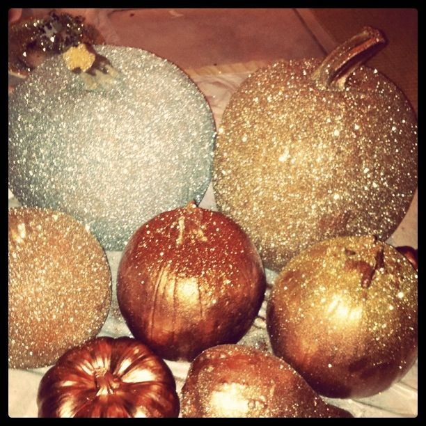 spray paint and glitter on pumpkins. -white and browns!