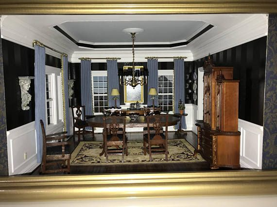 PICTURE THIS STUNNINGLY ELEGANT DINING ROOM MINIATURE SETTING ON DISPLAY IN YOUR HOUSE.  THE WALLS ARE PAINTED USING BLACK ON BLACK WITH TWO TYPES OF PAINT FINISHES TO CREATE THE STRIPPED EFFECT. PICTURE FRAME MOLDING DECORATES THE WALLS BENEATH THE CHAIR RAILING. THE ROOM FEATURES A