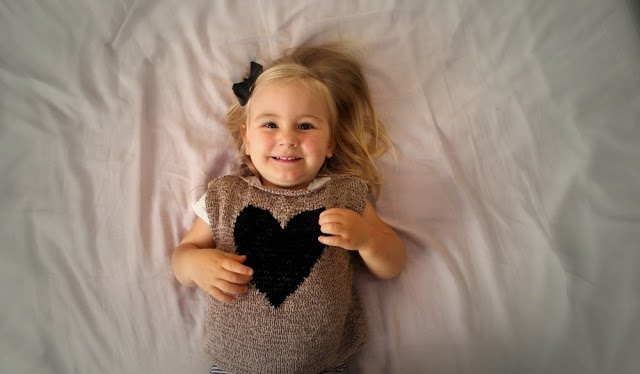 Knitted pull-over vest with a heart