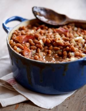 Crockpot recipe for baked beans, using navy beans and molasses. Baked beans recipe with salt pork, onion, and molasses and brown sugar and mustard.