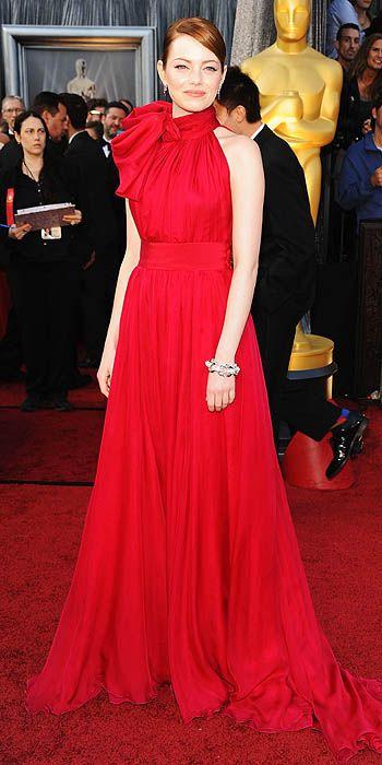 The Academy Awards 2012: Emma Stone in a scarlet Giambattista Valli dress and Louis Vuitton rubies.