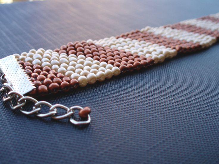 https://www.etsy.com/listing/192752474/beige-and-bronze-bead-bracelet?ref=listing-shop-header-2