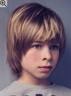 medium length boys hairstyle with long bangs and covered