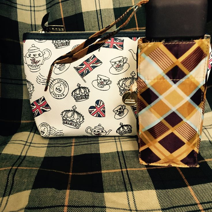 Three limited edition travel clutches for the woman or girl who loves Barbour and all things British plus a travel clutch size mini umbrella for light rain and emergencies.  The mini umbrella also fits perfectly into the pocket of Barbour Bedale or Beadnell jacket.   (brown tartan plaid mini umbrella)