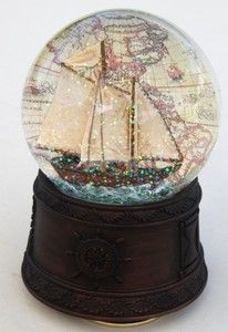 Musical Snow globe - Tall ship sailing with vintage map as backdrop