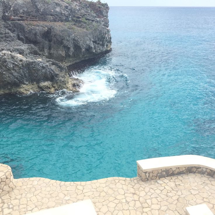 My husband and I jumping off the famous cliffs in Negril