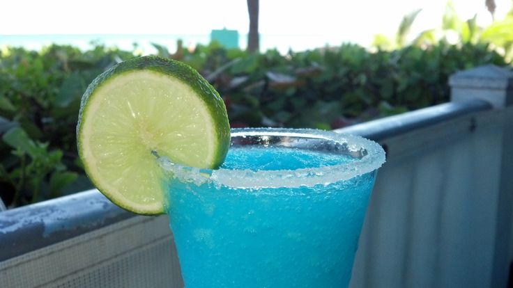 BEST Blue Curacao Margarita ever made by Carlos at Marena's Resort in Sunny Isles, FL. INGREDIENTS Coarse salt 1 lime, cut into wedges 4 ounces tequila 1 ounce Triple Sec 1/4 cup freshly squeezed l...