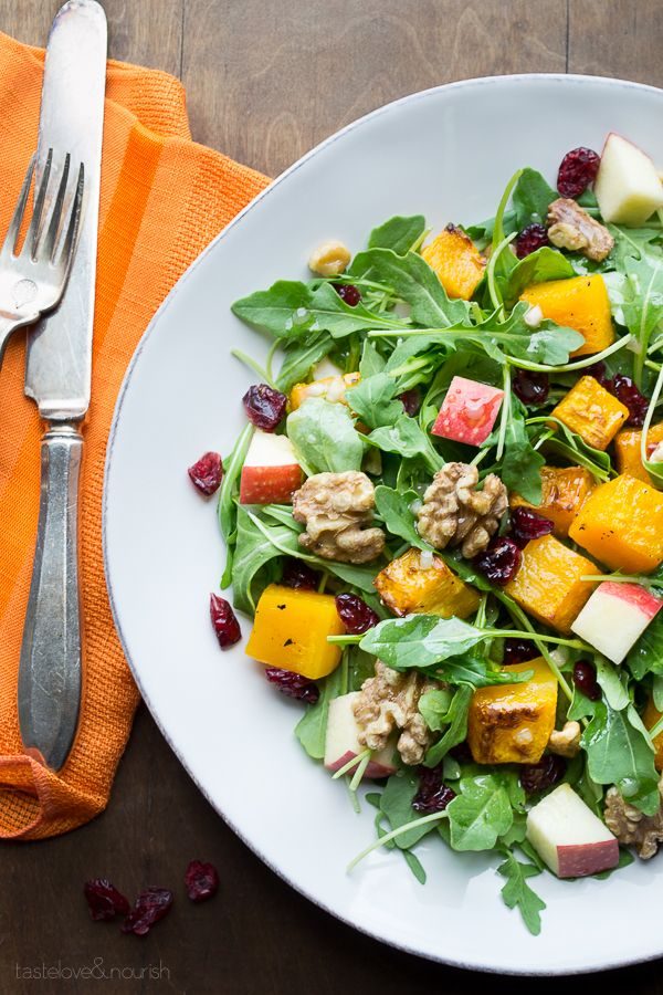 Baby Arugula Butternut Squash Salad with Maple Vinaigrette combines so many of the best fall flavors with an added bonus of being packed with super foods! The peppery arugula against the sweet roasted butternut squash, crisp fall apples, sweet and tangy cranberries and the buttery crunch from maple roasted walnuts will make this your new favorite too!