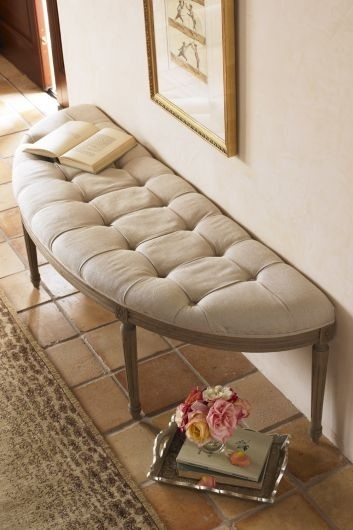 Half moon bench @ Entry Way. Baskets underneath.. Large Mirror behind with sconces on either side of mirror.