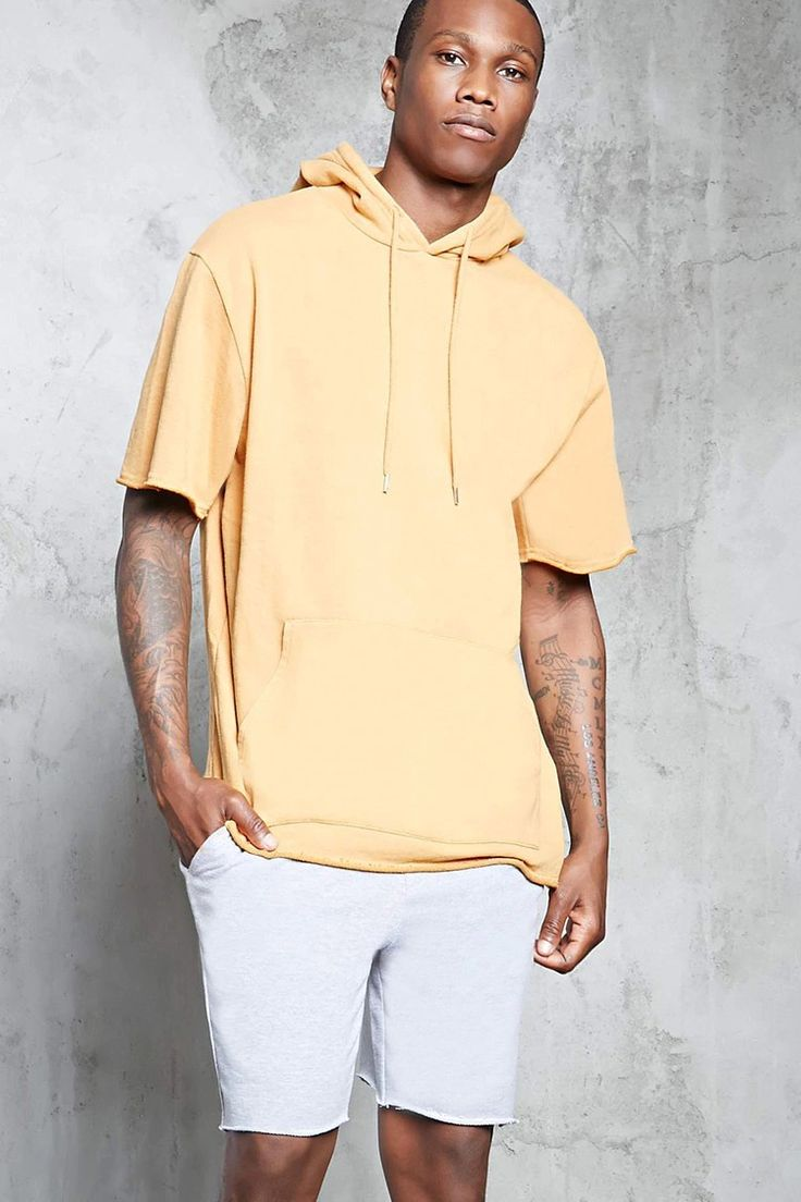 A French terry knit hoodie featuring a drawstring neck, short sleeves, a kangaroo pocket, and a raw-cut rolled trim.